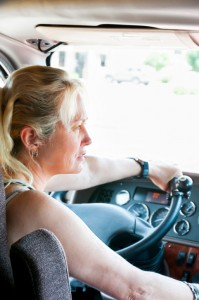 Female Trucker Driving A Semi-Truck